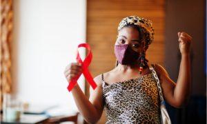 woman holding HIV ribbon symbol